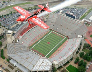LINCOLN, NE. 08/26/2009 -- Reporter Cory Matteson (left) and pilot Greg Poe pass over Memorial Stadium, Wednesday, August 26, 2009. Poe, who flies a Fagen ethanol powered high-performance MX2 aerobatic airplane, is appearing at the Offutt AFB Defenders of Freedom Air Show August 29th and 30th. WILLIAM LAUER/Lincoln Journal Star